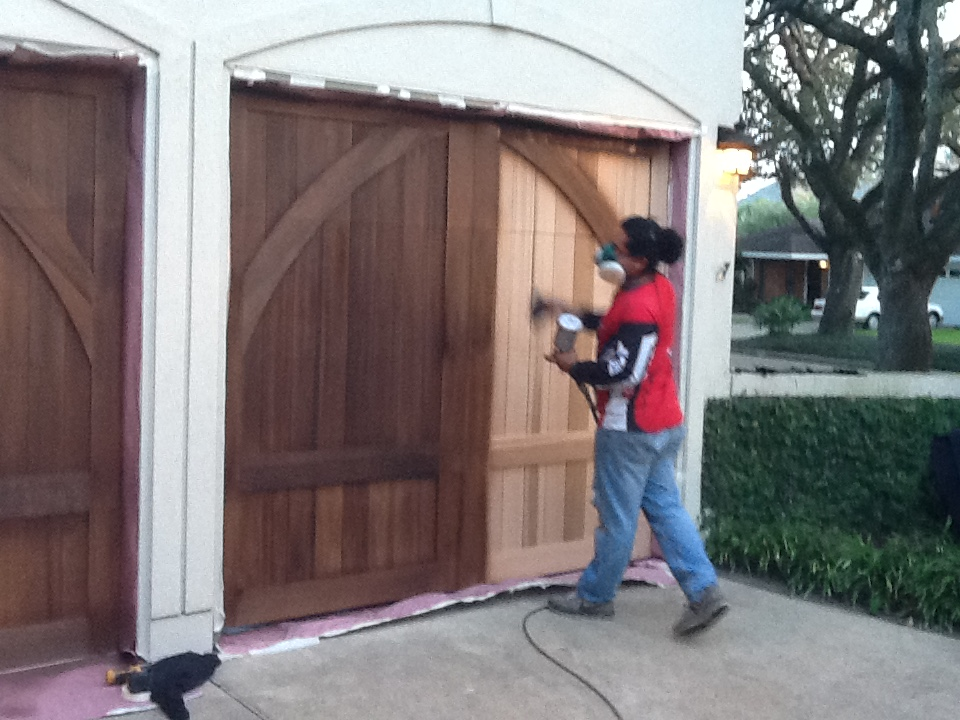 While We Are Doing The Process Of The Refinishing , We Make Sure All Areas  Surrounding The Garage Doors Are Covered .We Strip And Make Sure All Extra  Paint, ...